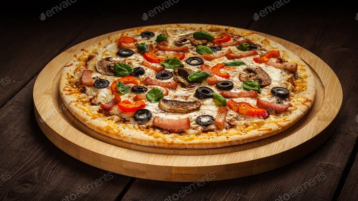 Ham pizza on wooden background