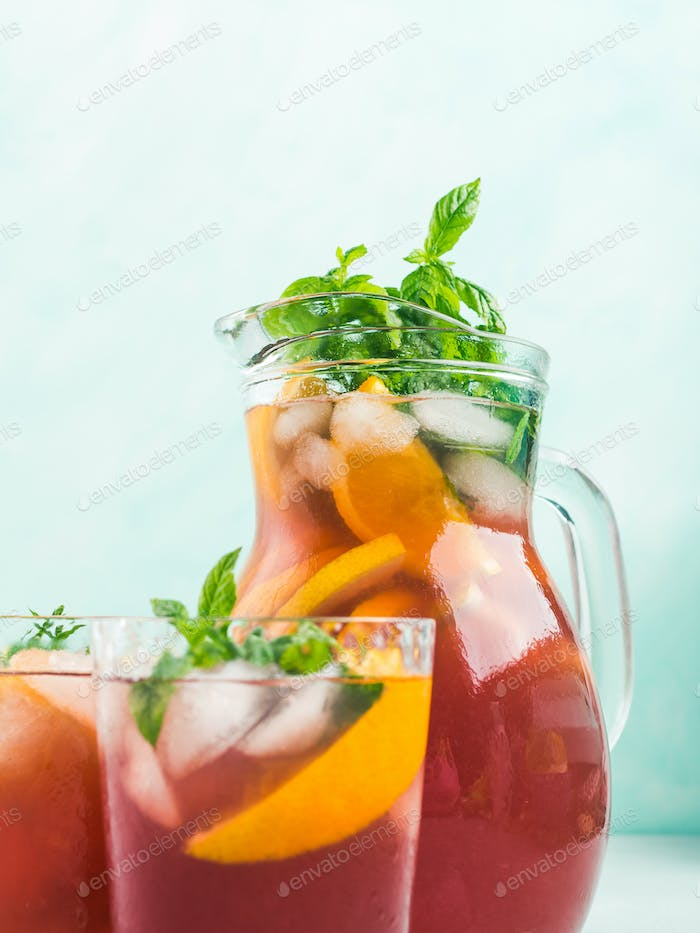 Fresh red coktail sangria in pitcher and glasses