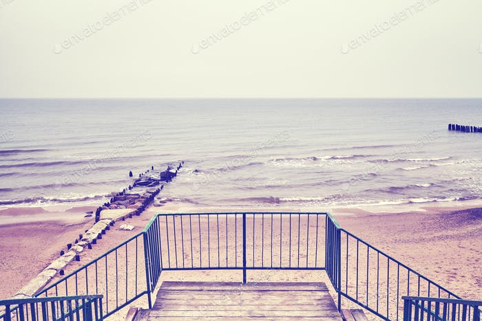 Vintage toned picture of stairs to a beach, Baltic Sea.