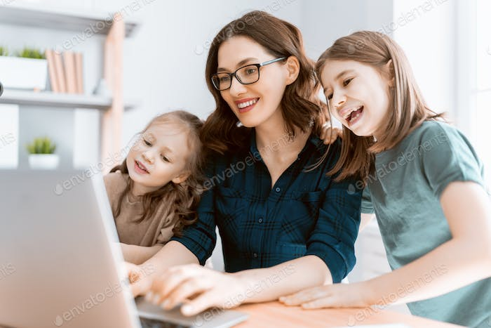 mother with children working on the computer