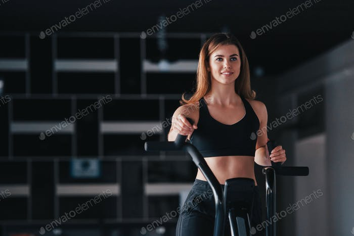 Photo of gorgeous blonde woman in the gym at her weekend time
