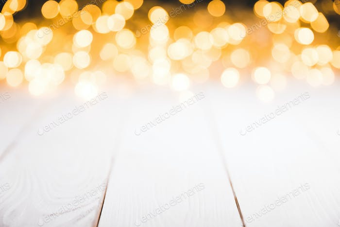 magical blurred lights on white wooden surface, christmas texture