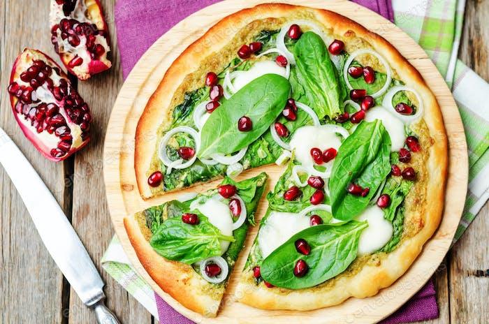 spinach pesto mozzarella onion pomegranate pizza