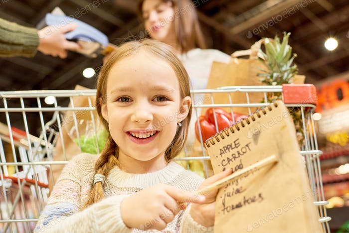 Happy Little Girl Holding Shopping List