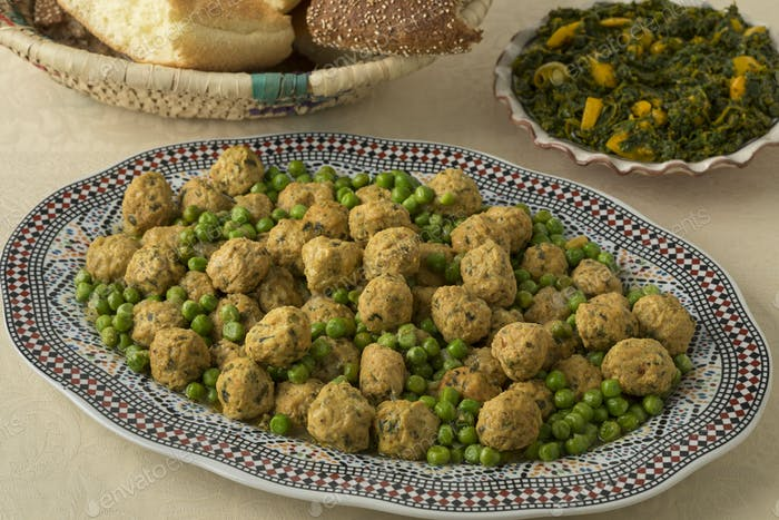 Dish with Moroccan style minced chicken balls and green peas