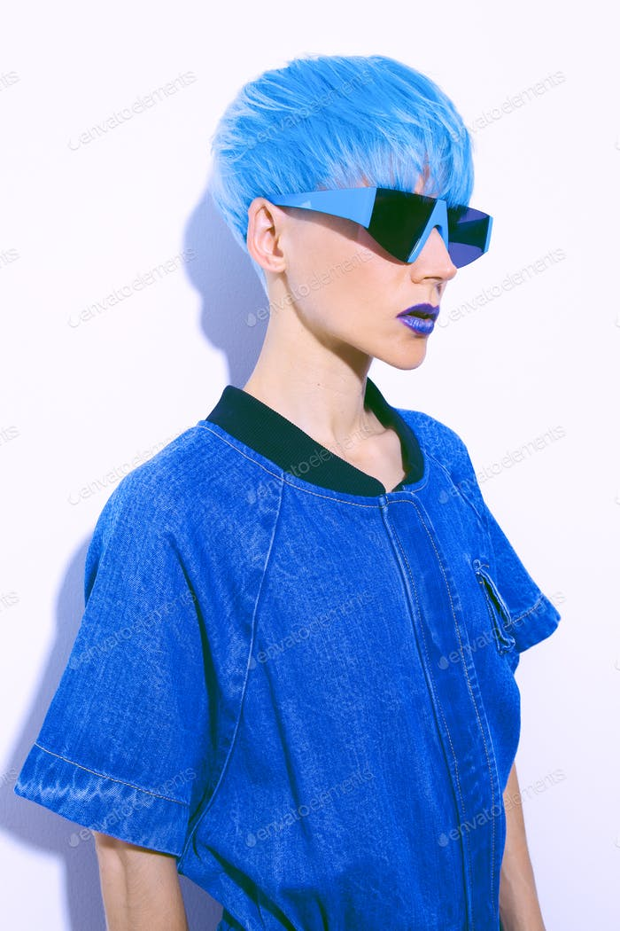 Fashion Girl with blue short hair. Trendy colours hair style concept