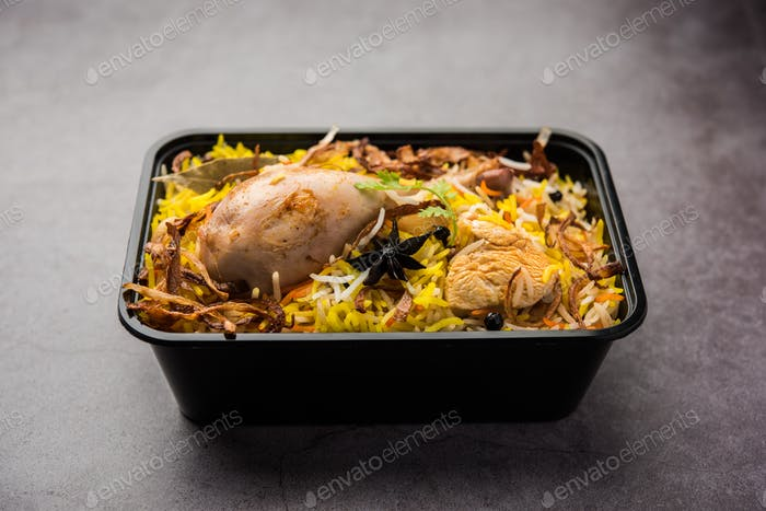 Online Food Delivery - Chicken Biryani packed in Plastic box