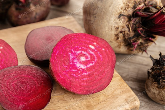 Red beet root on wooden table