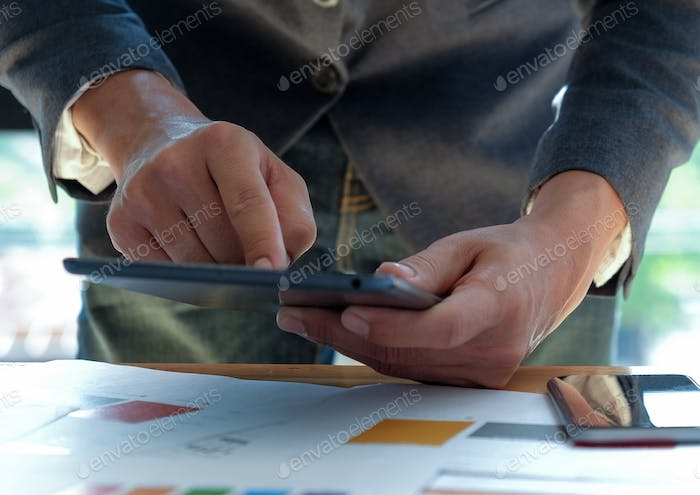 Business people working at office desk and using touch screen ta