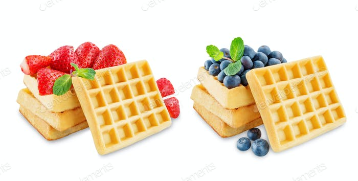 Waffeles berries and mint leaf on a white background