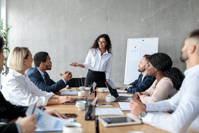 Businesswoman Making Business Presentation For Colleagues In Modern Office