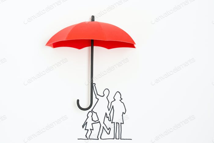 Family protection insurance concept using red umbrella
