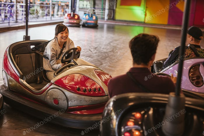 Friends having fun on bumper car ride
