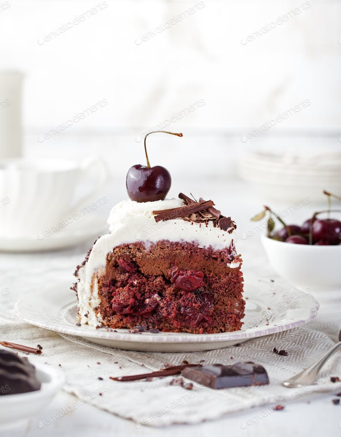 Black forest cake ,decorated with whipped cream and cherries Schwarzwald pie, dark chocolate