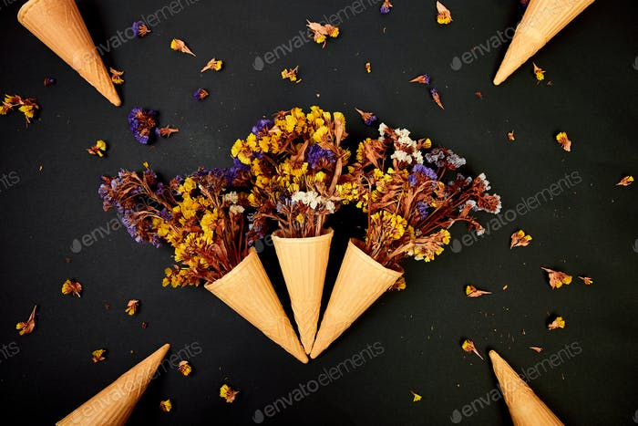 Bouquet Flowers in a waffle cone on a black background