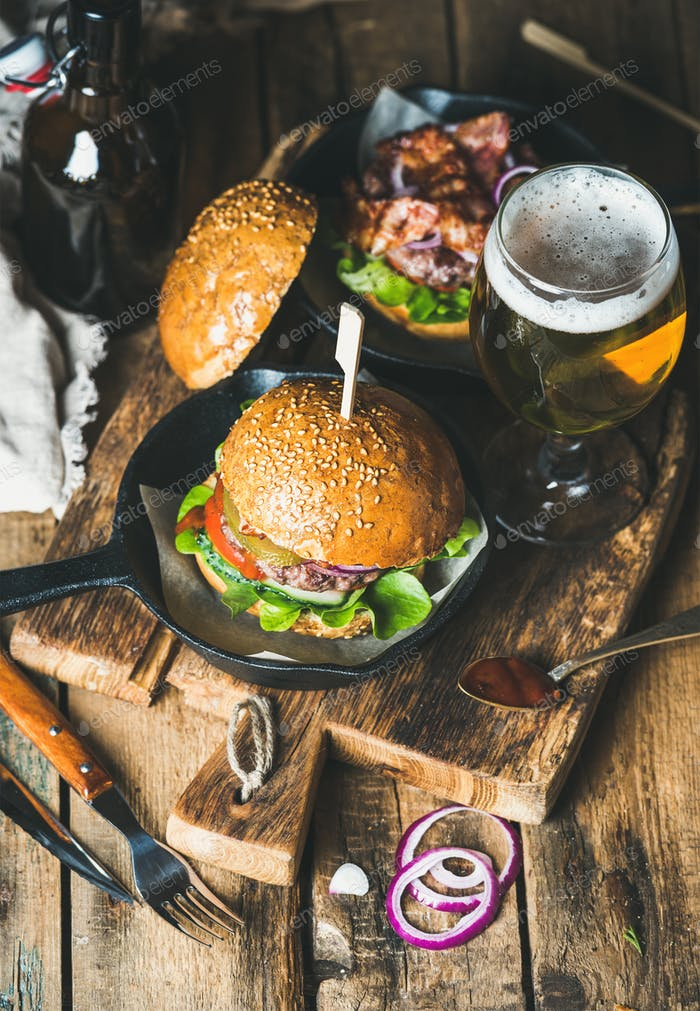Beef burgers with crispy bacon, fresh vegetables and wheat beer