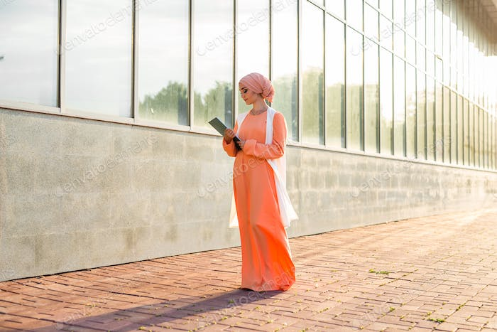 Muslim woman holding document paper