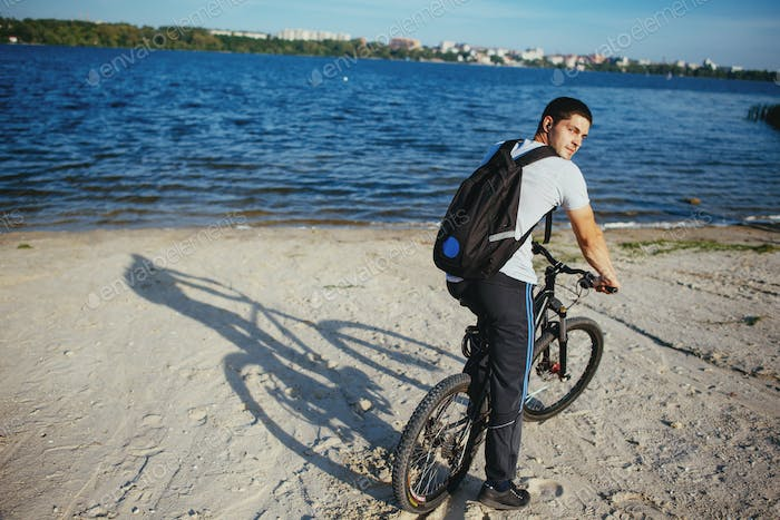 Cyclist riding a bicycle in the beach