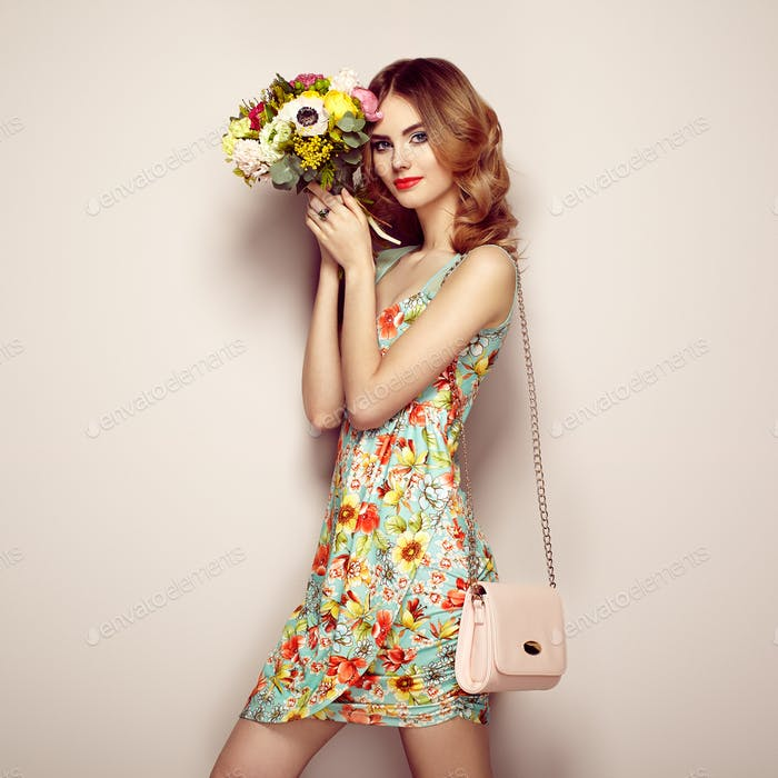 Blonde young woman in elegant floral dress