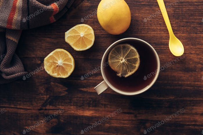 Cup of tea and fresh lemon, top view