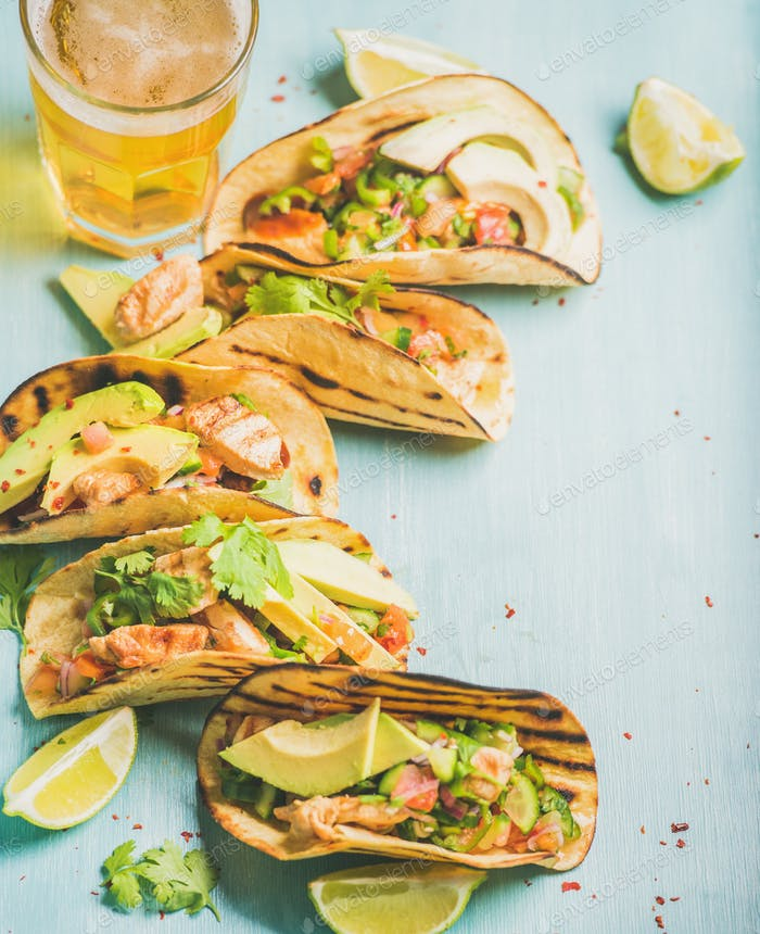 Corn chicken and avocado tortillas, beer in glass, copy space