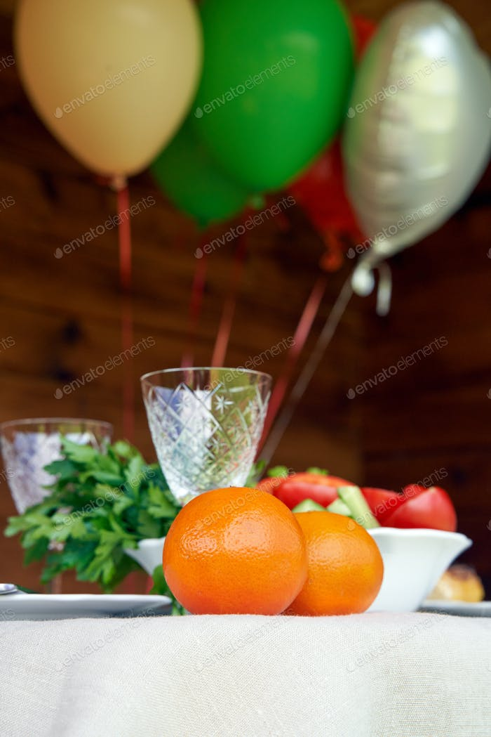 Table full of vegeterian food with air balloons on wooden background