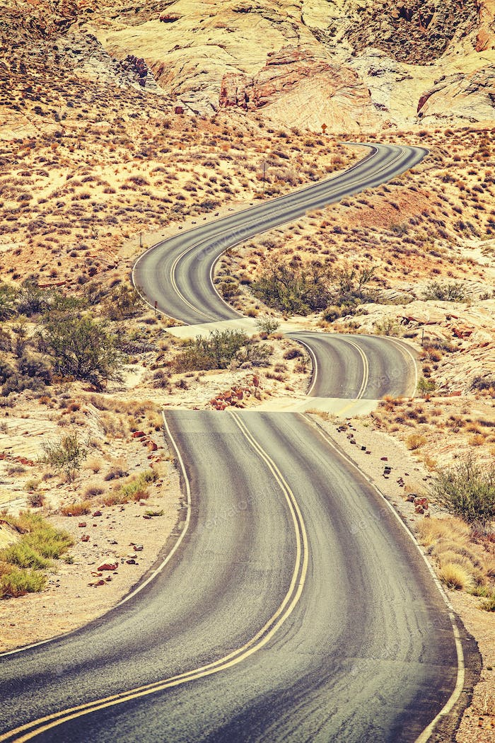 Old film retro stylized picture of a scenic winding road, USA