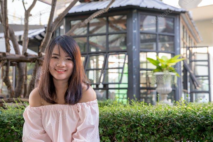 Young smiling woman outdoors portrait. Soft sunny colors.Close portrait.