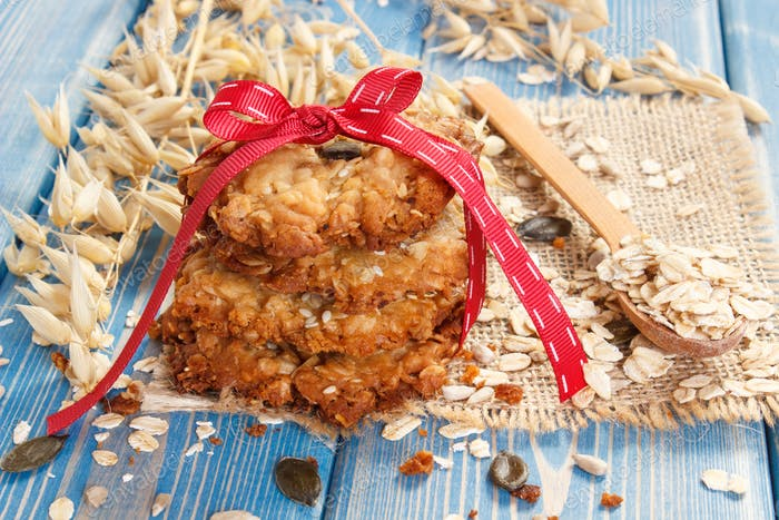 Oatmeal cookies with ingredients and ears of oat