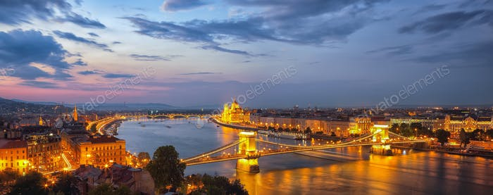 View at Chain bridge, river Danube and famous building of Parliament.