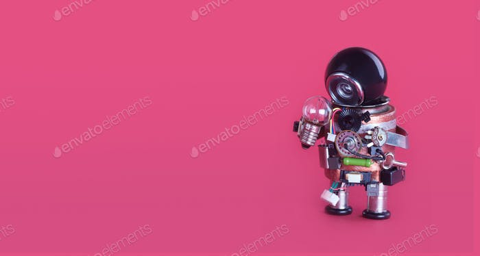 Machine learning and creative idea concept. Funny robotic toy holds light bulb
