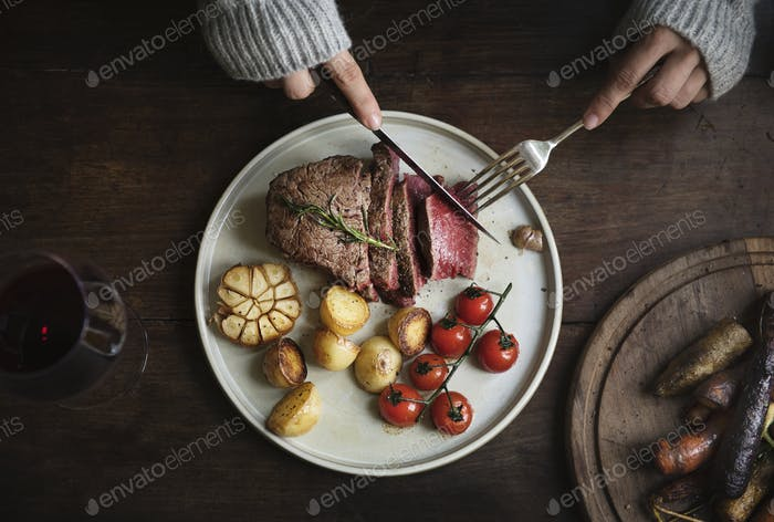 Close up of a cutting a fillet steak food photography recipe idea