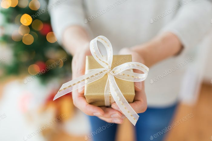 close up of male hands with christmas gift