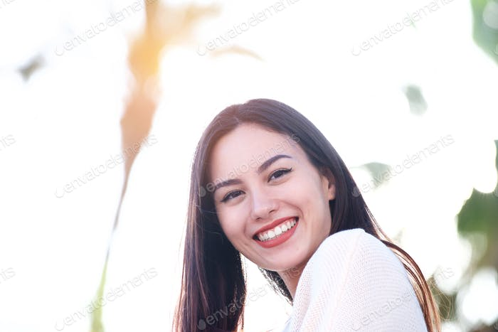 Close up of beautiful friendly woman smiling outside