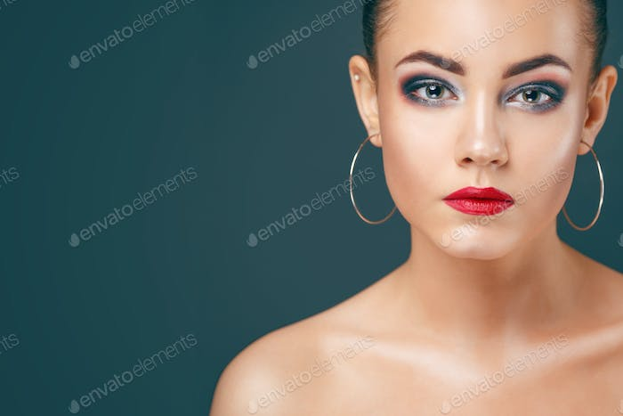 Young beautiful woman with clean face and shining skin.