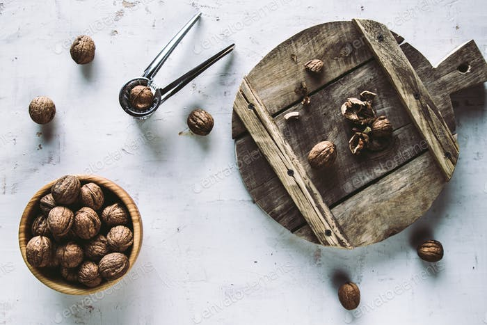 Walnuts in wooden bowl on table with Nutcracker