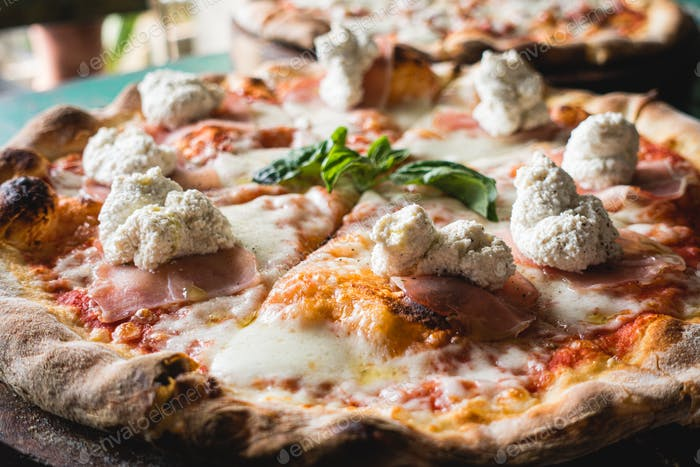 Pizza with ricotta cheese close up