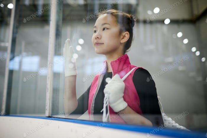 Inspired Asian Girl in Ice Arena