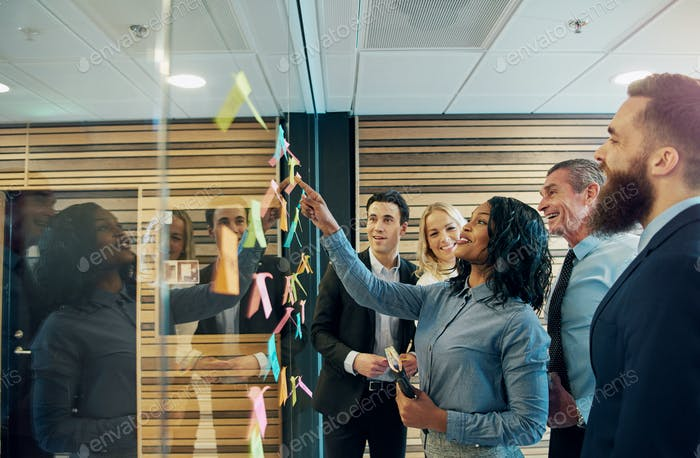 Cheerful entrepreneur team talking in the office
