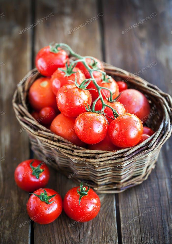Fresh ripe tomatoes in a basket