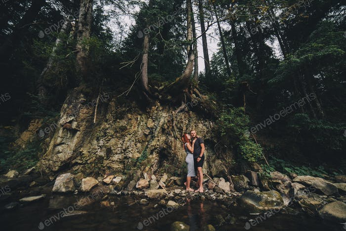 beautiful couple on the background of forest