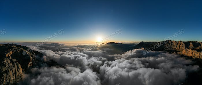 Panoramic view of sunset in the mountains with clouds