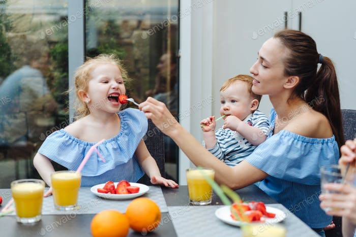 Happy family, fresh fruit breakfast