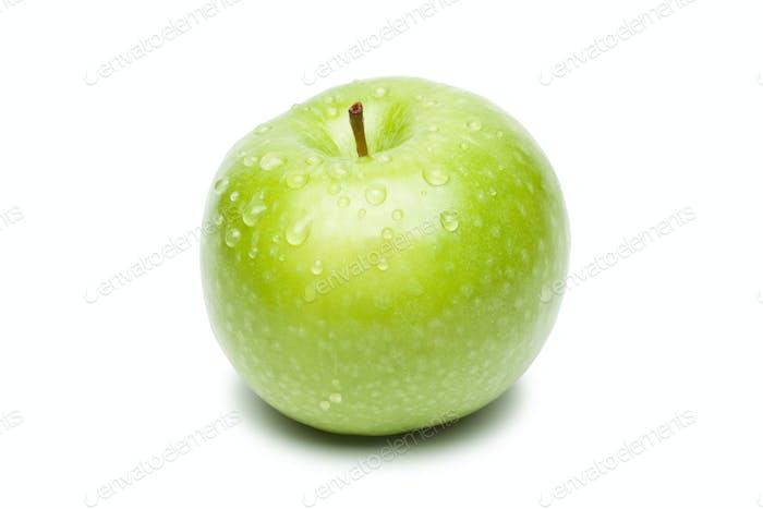 Manzana verde fresca con gotas de agua