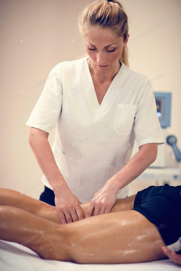 Leg massage. Physical therapist massaging leg
