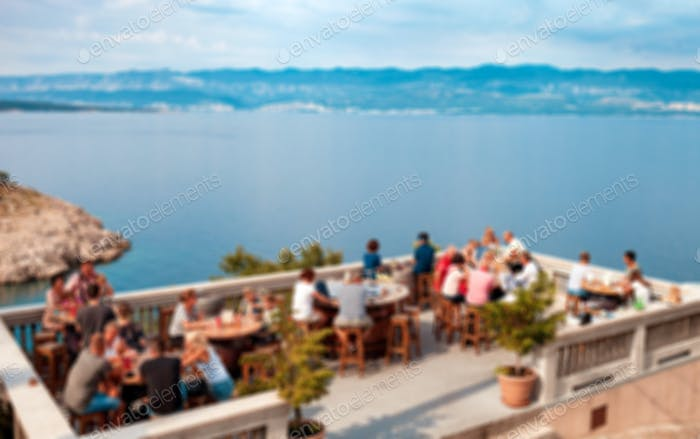 Blurred background, restaurant terrace with sea view