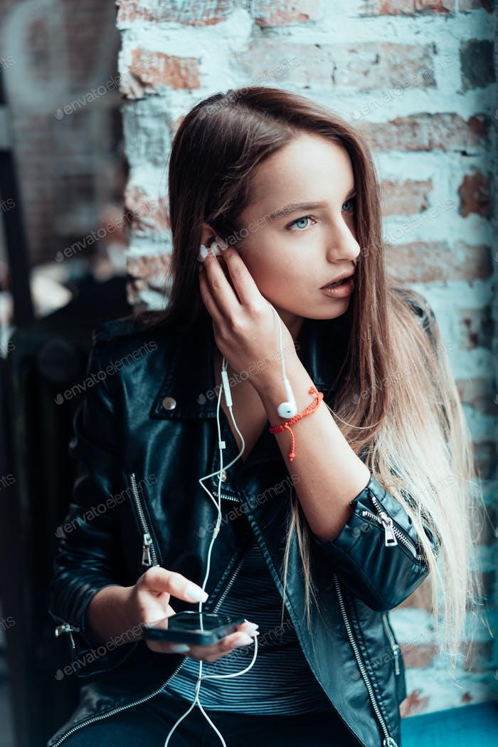 Beautiful girl listening music