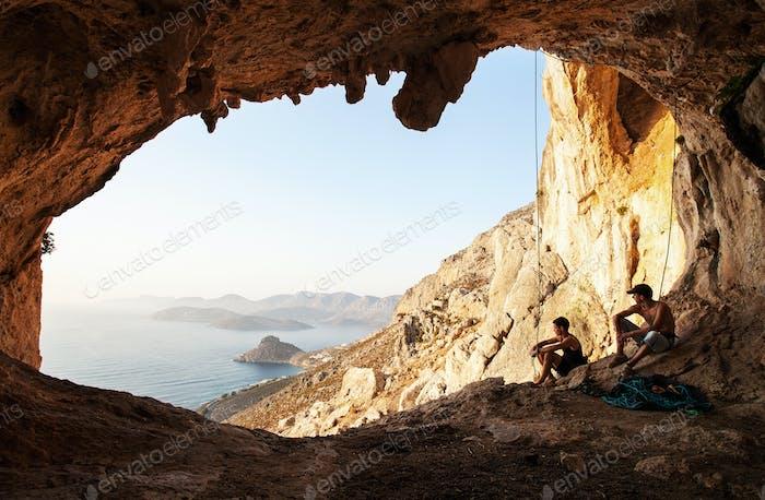 Two rock climbers having a rest. Kalymnos Island, Greece