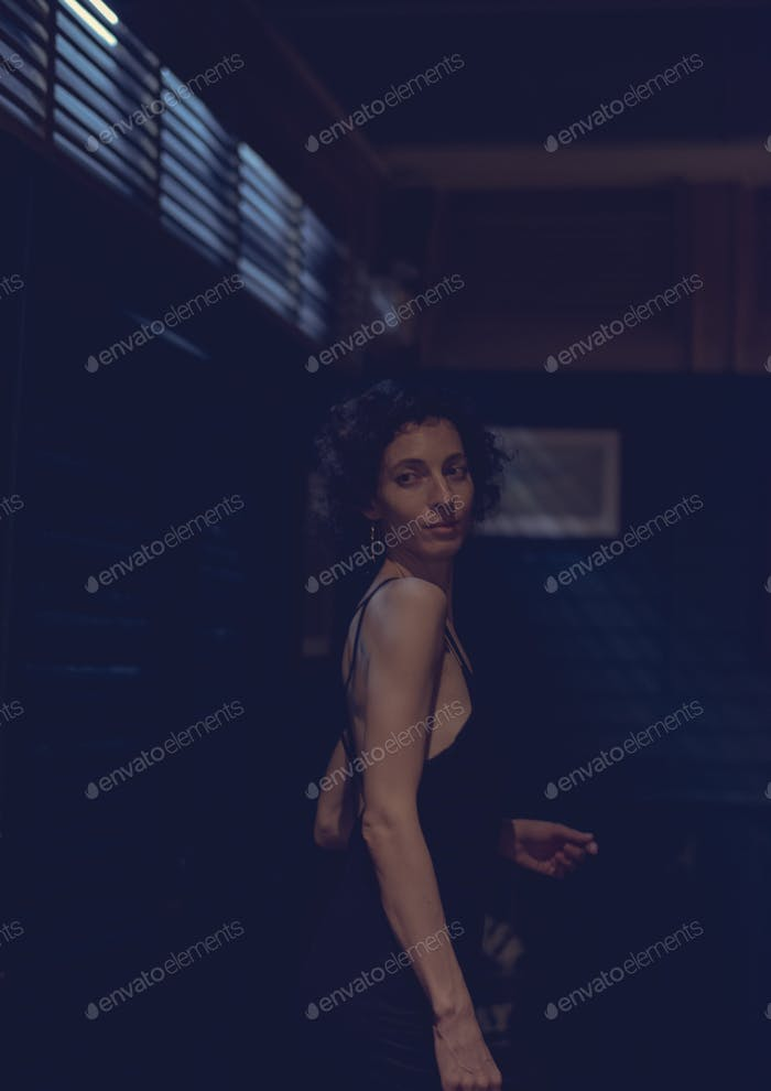 Portrait of a lone woman at a bar