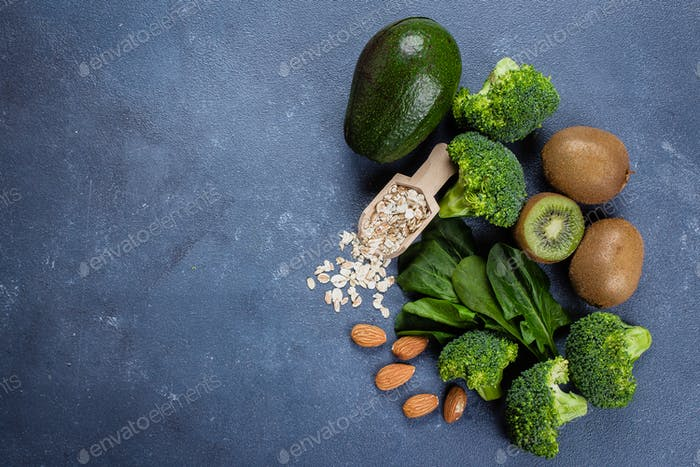 Ingredients for Healthy Green Smoothie. Broccoli, avocado, spinach, kiwi, oats and almond